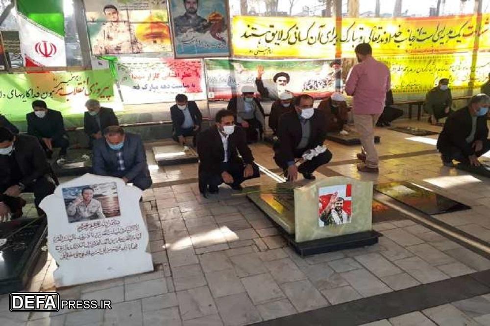 1228563 909 - عطرافشانی گلزار شهدای نکا به مناسبت دهه مبارک فجر